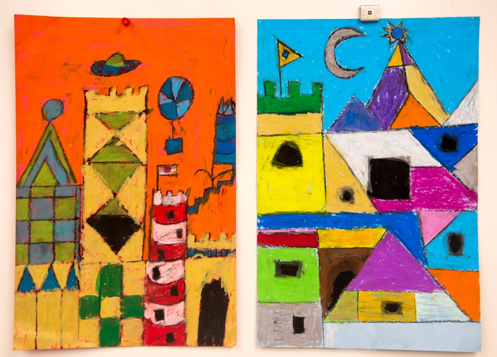 "Two 3rd grade students' oil pastel ""cityscapes"" inspired by Paul Klee's magic square paintings"