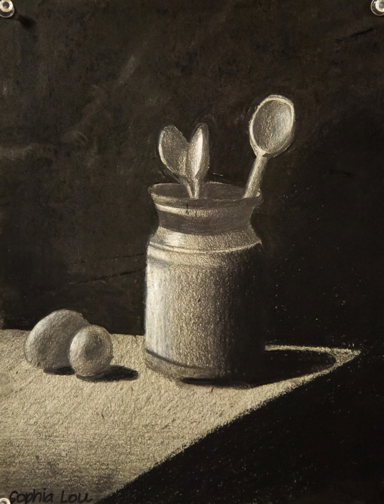6th grade - chiaroscuro still life drawing in graphite and charcoal representing two eggs on a table and a jar with three wooden spoons in it