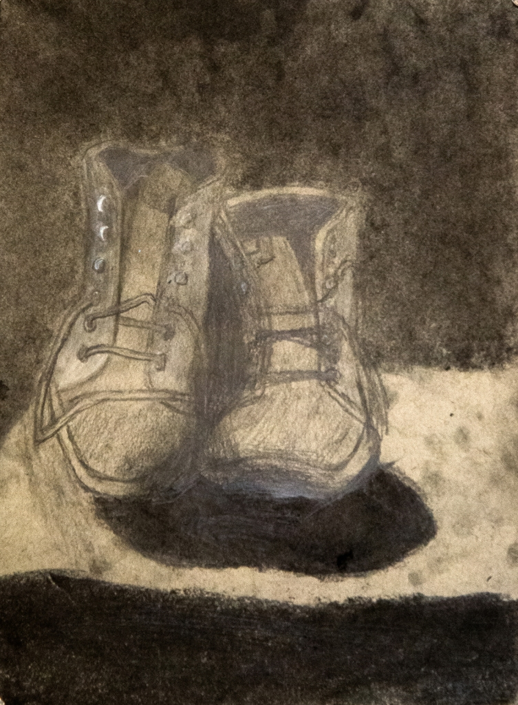 6th grade - chiaroscuro still life drawing in graphite and charcoal representing beat up worker's boots