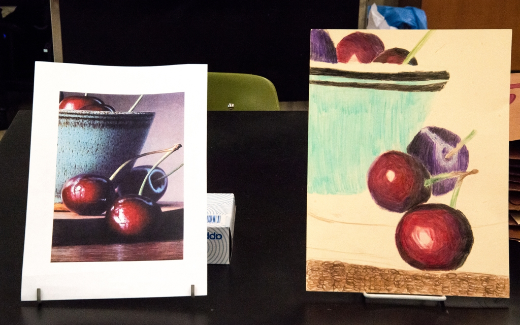 7th grade colored pencil still life in progress of a bowl of cherries