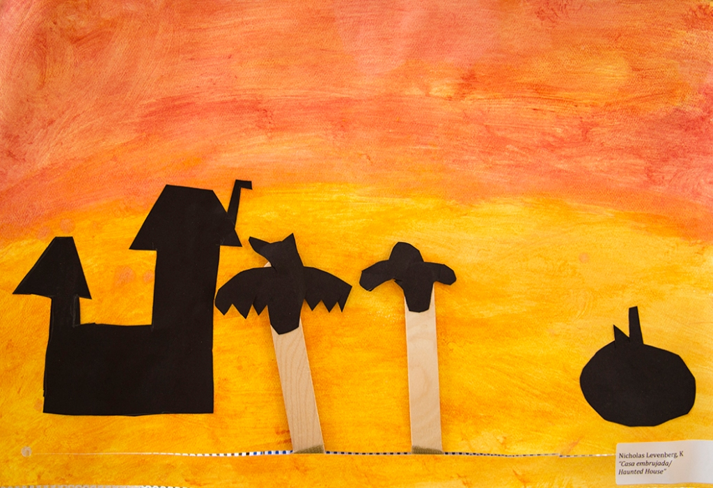 Kindergarten - A student's Halloween shadow puppets of a bat and ghost with sunset background