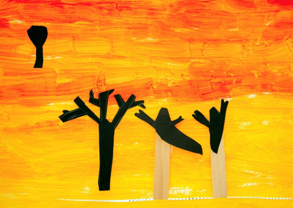 Kindergarten - A student's Halloween shadow puppets of two ghosts with sunset background