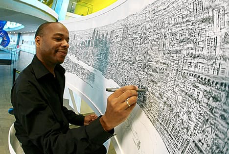 Artist Stephen Wiltshire working on one of his cityscape panoramas
