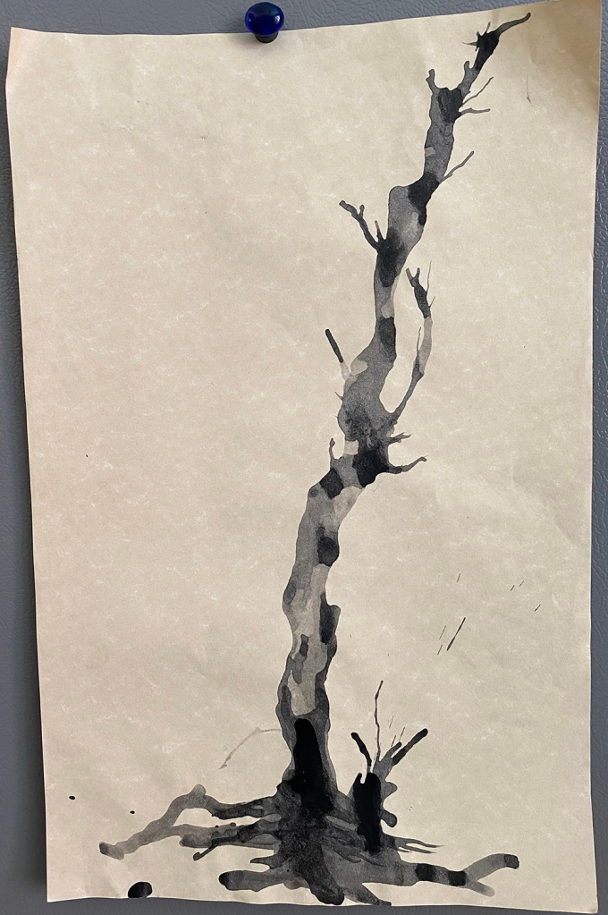 This is one 1st grade student's straw-guided tree trunk before adding the cherry blossoms.