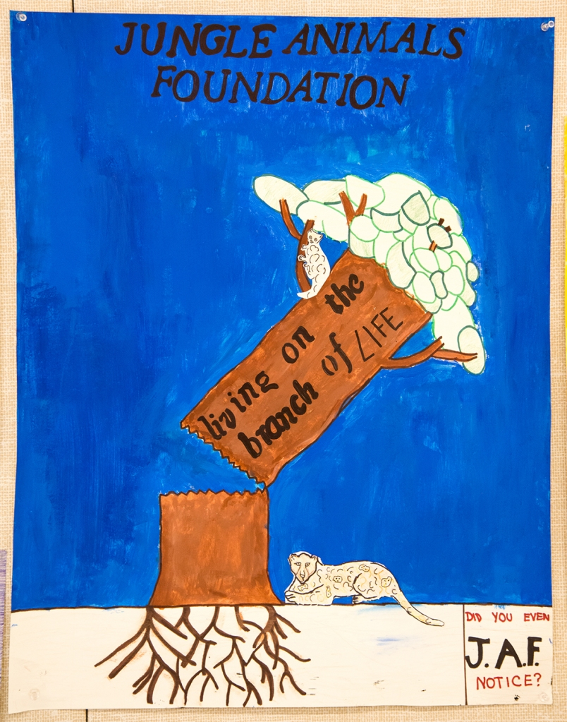 6th grade art lesson - Nonprofit organization advertisement to save jungle animals