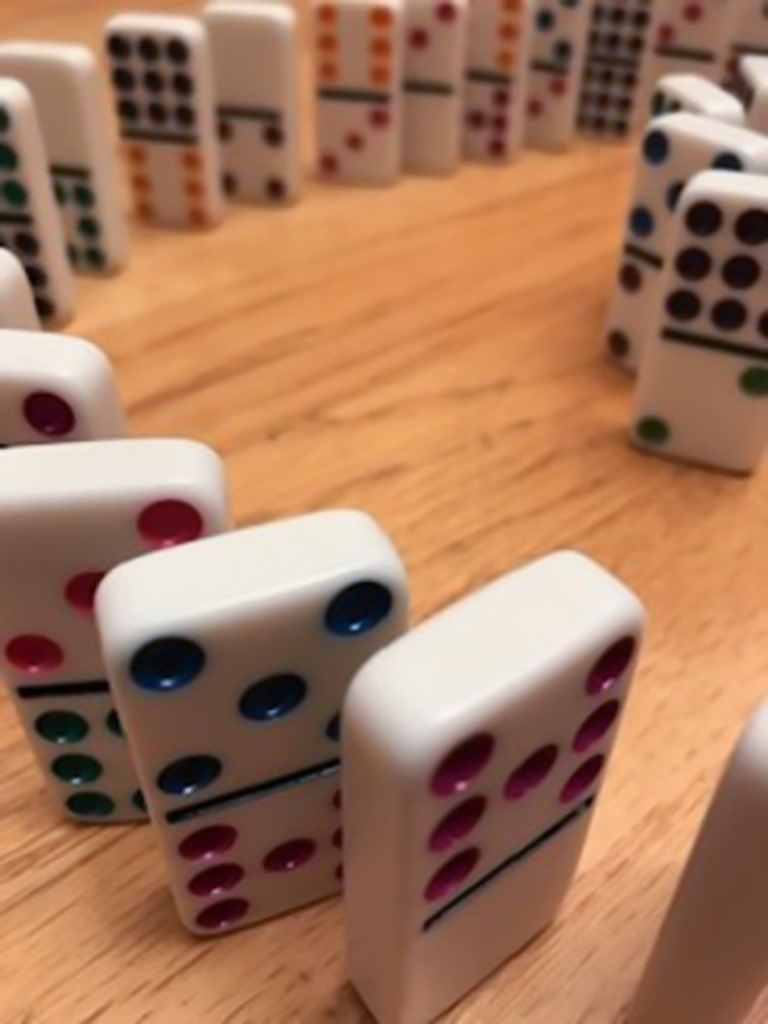 8th grade student image of dominoes using aperture manipulation to express a shallow depth-of-field