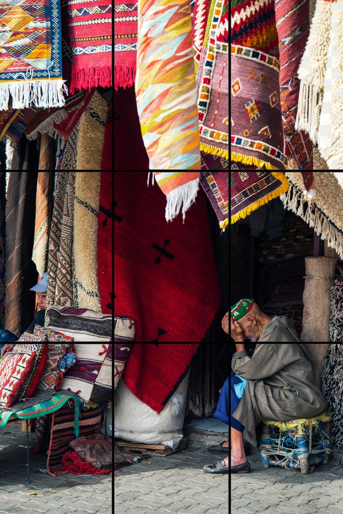 This image demonstrates the rule of thirds; notice the placement of the subject. Rug vendor in Marrakech, Morocco, ©Anita Sagastegui