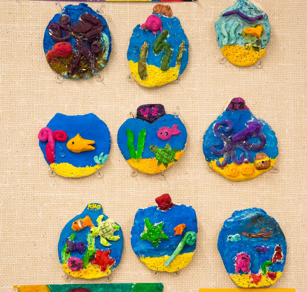 3rd grade students' completed clay aquarium relief sculptures, including paint