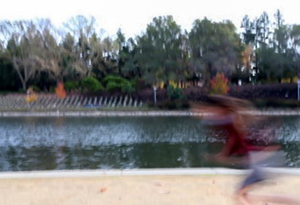 A student helped out another by being the blurred, running model for a shot of motion blur