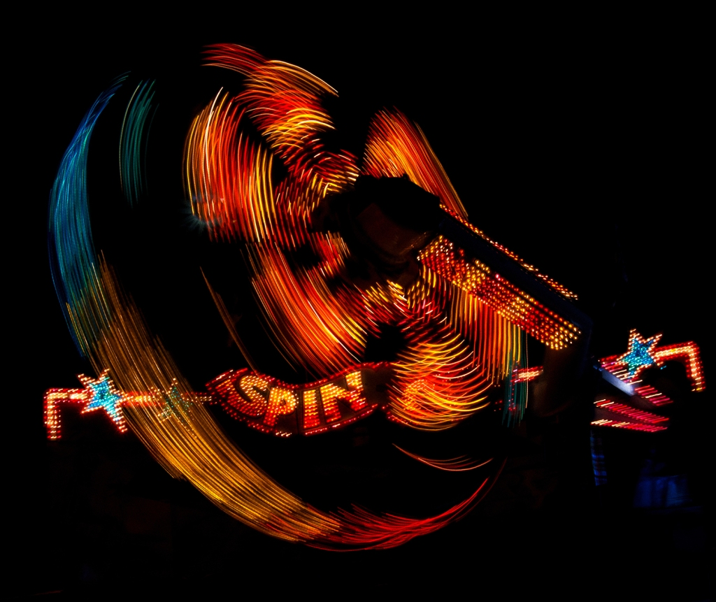 """A slower shutter speed captures the motion of this lit amusement park ride ay night. """"Lights of Alameda County Fair"""" © Anita Sagastegui"""