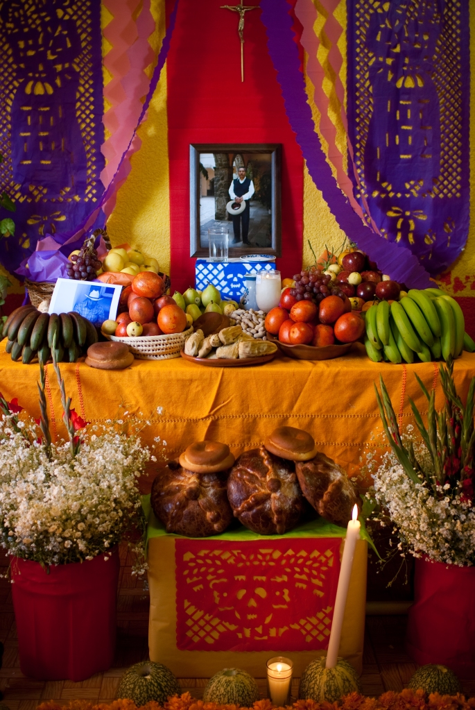 An example of an 'ofrenda' or altar of offerings for our deceased loved ones, with bread, fruit and candles