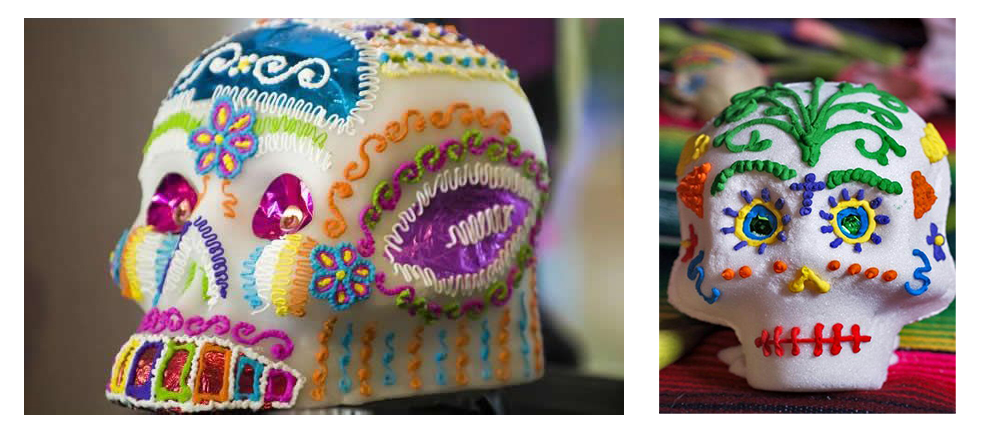 Some elaborately decorated, colorful little sugar skulls