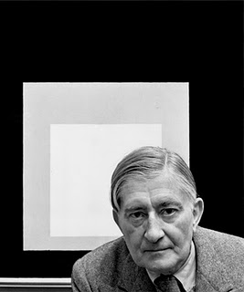 >Josef Albers with one of his paintings from the series Homage to the Square