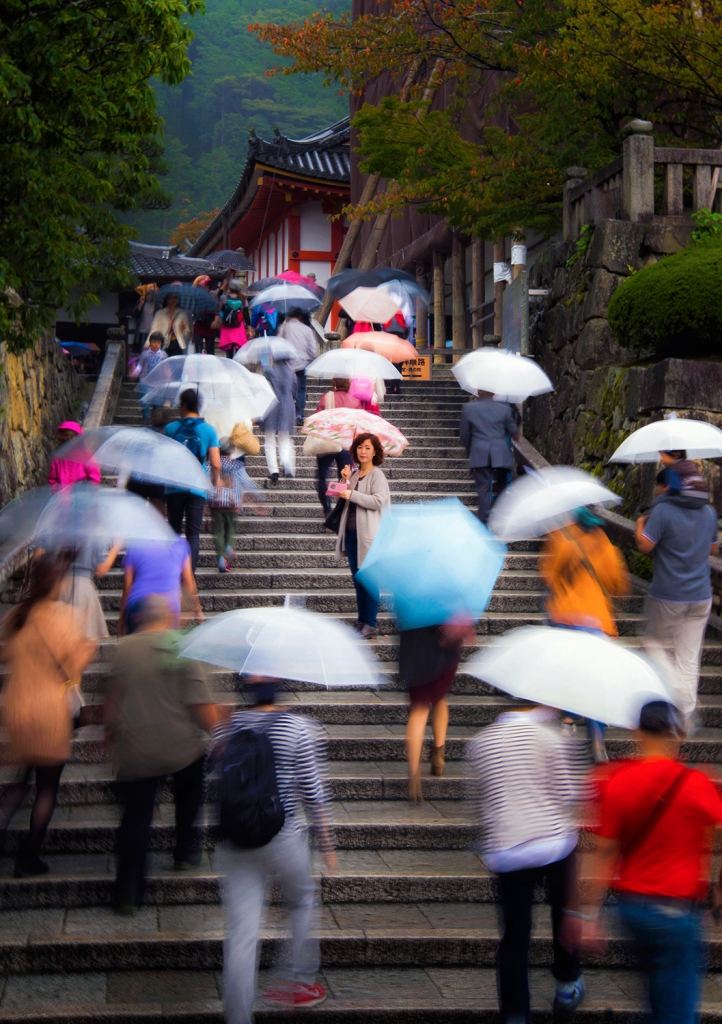 """On this rainy day, a slow shutter speed allowed for a little blur of the umbrellas and people. """"One Who is Still"""", Kyoto, Japan, © Anita Sagastegui"""