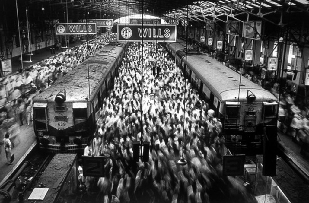 Church Street Station, 1995, © Sebastião Salgado--an image of an Indian train station capturing the blur of hundreds of people moving between the platforms