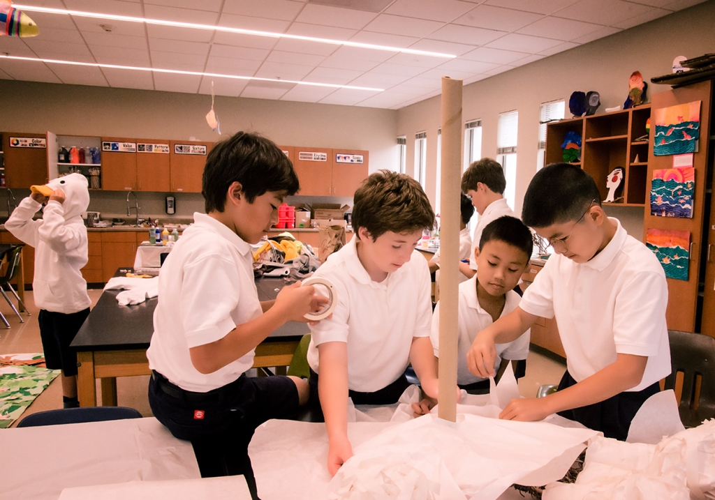 These 5th grade students were creating the giant's hands for the play 'Jack & the Beanstalk.' They designed and engineered the hands out of pliable but heavy wire for the skeleton onto which they paper-maché the skin. To manipulate the hands, they affixed cardboard tubes to the wire, and paper-maché over it to keep it one place.
