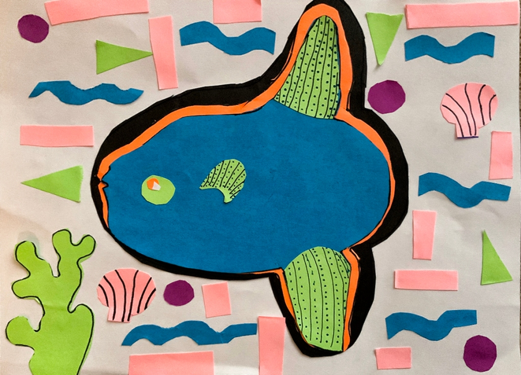 A 4th grade student Mola, depicting a blue and green fish and surrounded by geometric and organic patterns in blue, green, pink and purple.