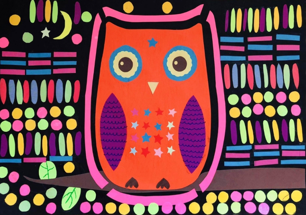 A 4th grade student Mola, depicting an orange owl that is adorned in multicolored patterns of stars, surrounded by a multicolored array of patterns in both organic and geometric shapes.