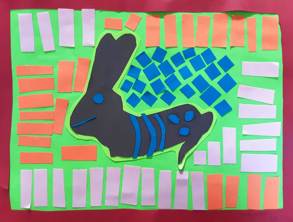 A 4th grade student Mola, depicting a black rabbit surrounded by shapes and lines of various colors