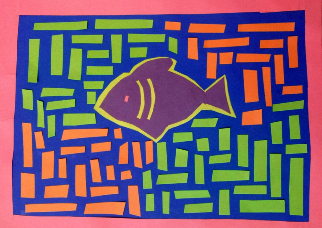 A 4th grade student Mola, depicting a purple fish surrounded by green and orange patterned lines