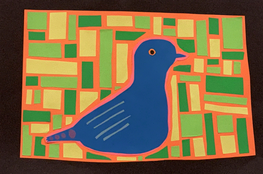 A 4th grade student Mola, depicting a blue dove with artistic patterns within its body, and surrounded by rectangles in various shades of green.