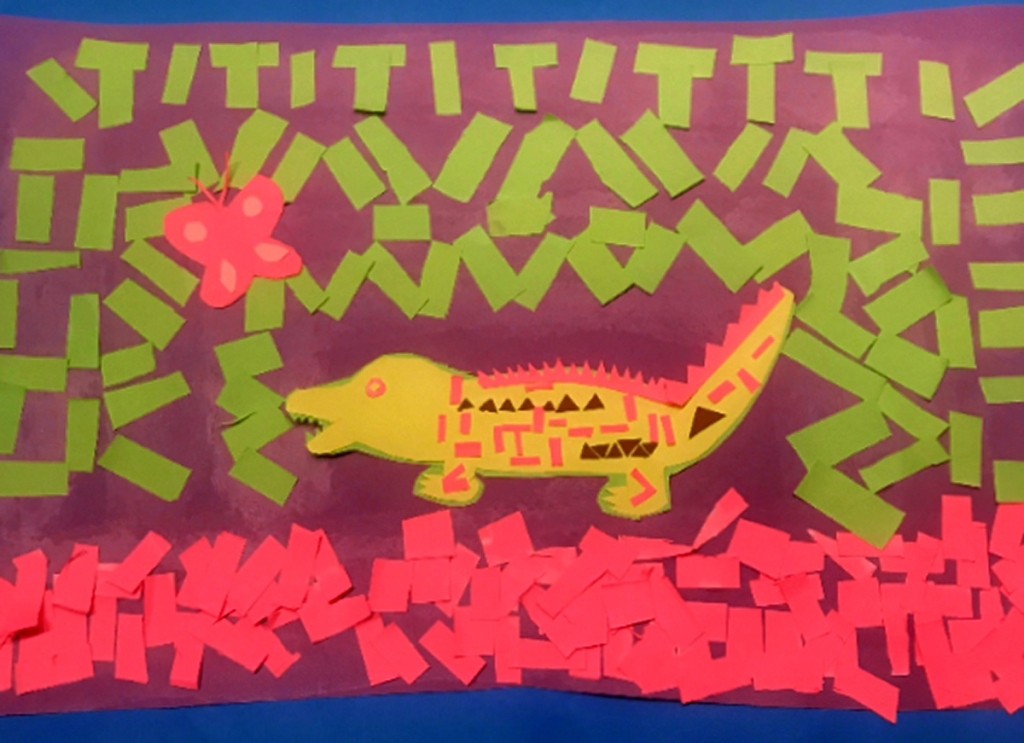 A 4th grade student Mola, depicting an intricately patterned yellow alligator surrounded by multicolored patterns in green and pink, with a pink butterfly