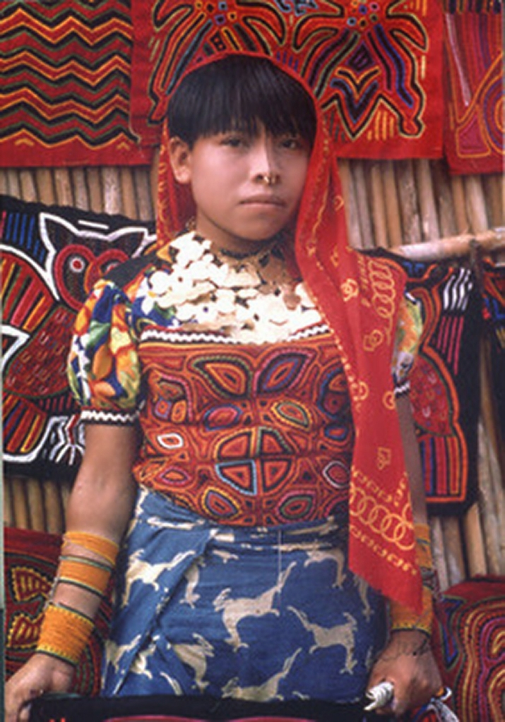 This is a Kuna woman of Panama wearing a traditional Mola around her chest