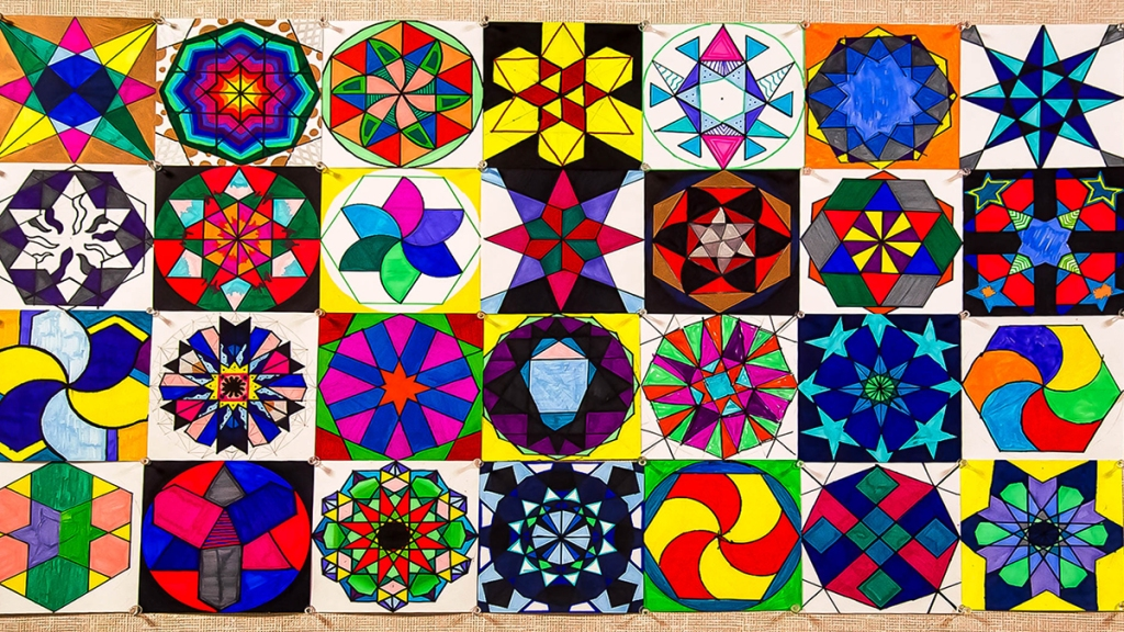 "Examples of 6th grade students' Arabic geometric ""tiles"" made by using mathematical steps as given in Eric Bourg's book ""Islamic Geometric Patterns"""