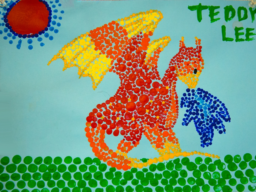 5th grade student's Aboriginal-style Dot Painting of a bright red and orange dragon.