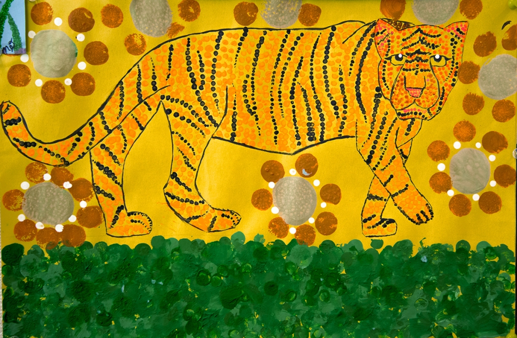 5th grade student's Aboriginal-style Dot Painting of a tiger in bright yellows and oranges.