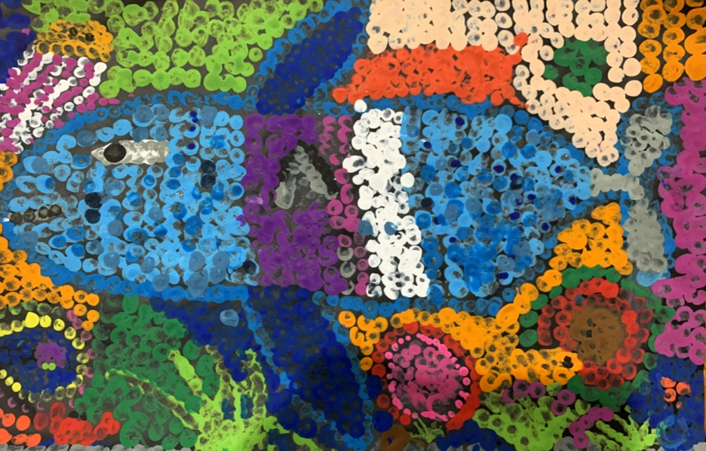 5th grade student's Aboriginal-style Dot Painting of a large fish in vivid rainbow colors.