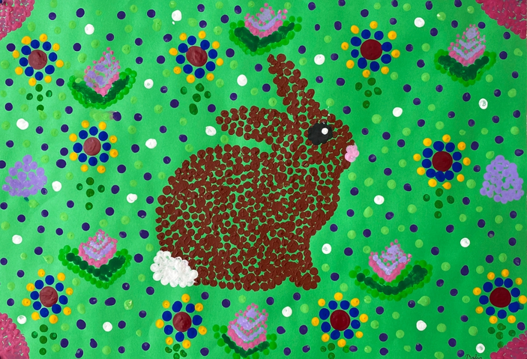 5th grade student's Aboriginal-style Dot Painting of a rabbit surrounded by flowers.