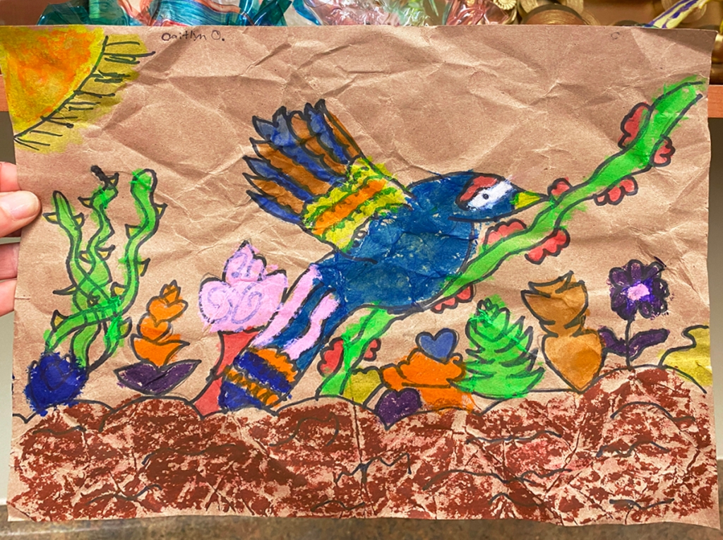 3rd grade student Amate painting example featuring a colorful and brightly-patterned bird, as well as several colorful plants