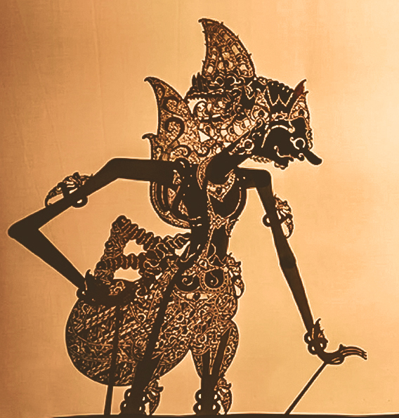 An example of a Wayang Kulit puppet, demonstrating the intricate, lace-like pattern perforated into the puppet's costume.